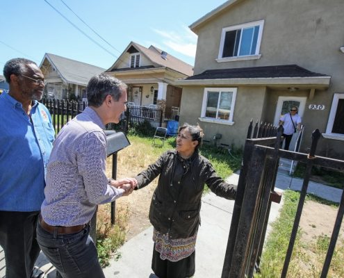 Mayor Garcetti and Councilmember Curren Price visiting neighbors on Central Avenue.